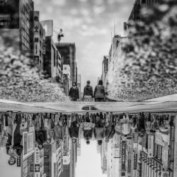 Tokyo Puddle Reflection by Jerard Touren