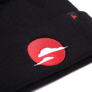 sky & cloud black bobble beanie hat closeup
